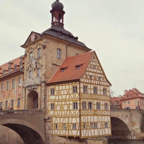 A close up of an old building with Bamberg in the background