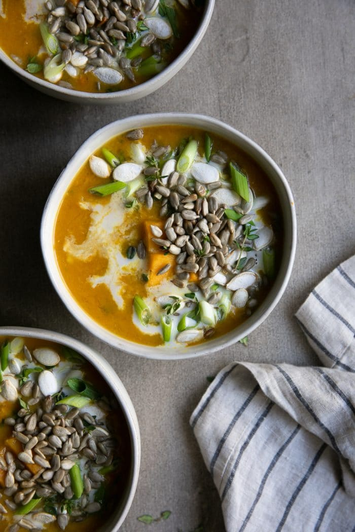 overhead image of 3 bowls of Healthy Curry Lentil Soup