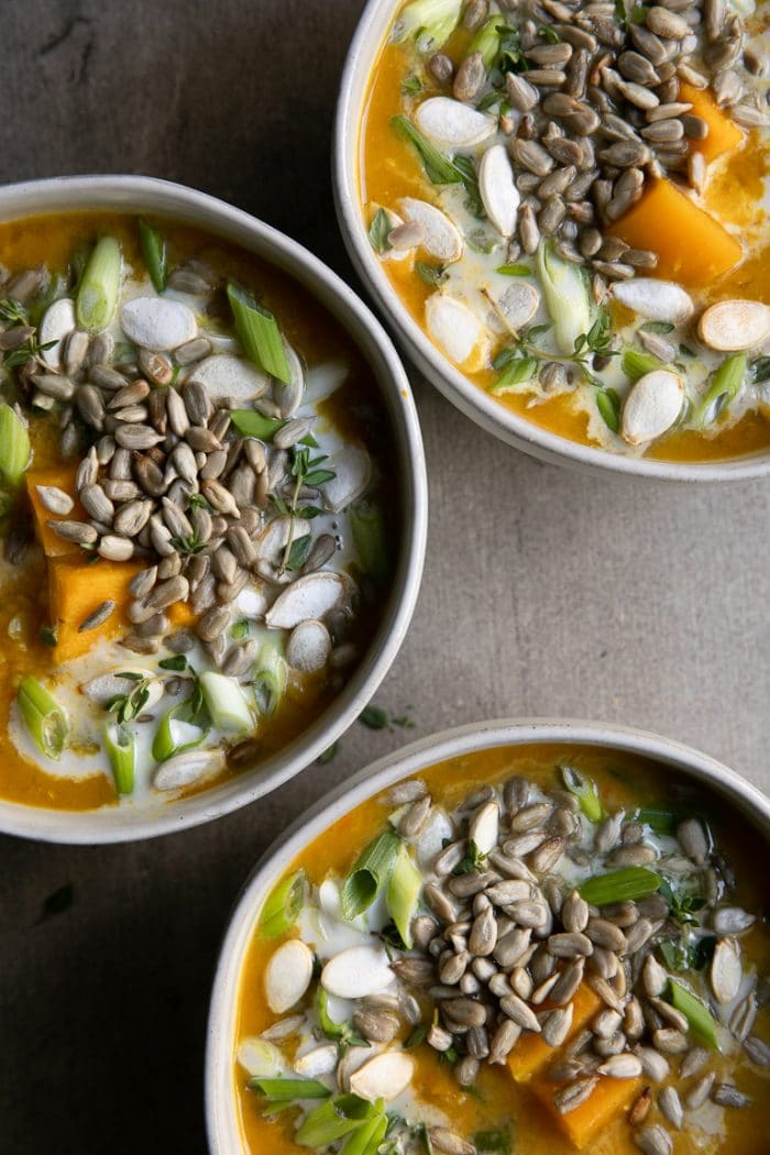 3 white bowls full of Healthy Curry Lentil Soup