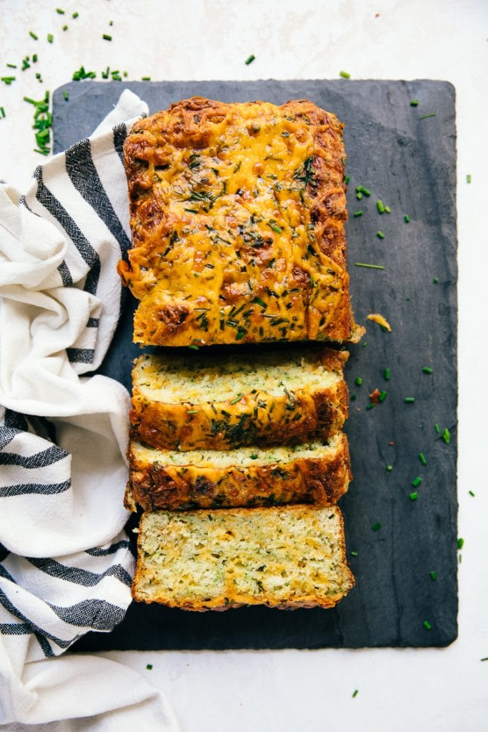 Sliced savory quick bread with cheddar cheese and zucchini