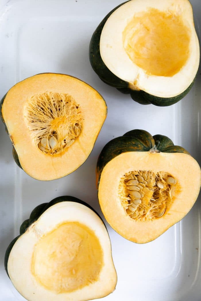 Halves of acorn squash flesh-side-up