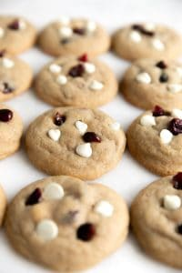 Fluffy baked golden cookies topped with white chocolate chips and dried cranberries.