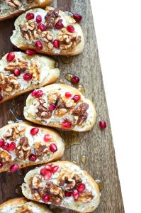 honey walnut goat cheese crostini on wood