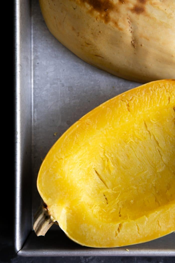 Oven roasted spaghetti squash halves in a baking dish.
