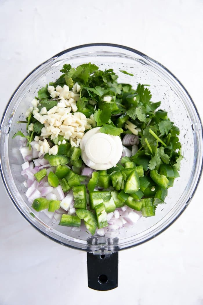 CIlantro, garlic, shallots in a large food processor.