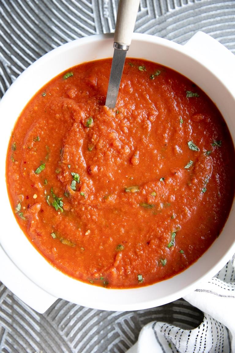 A close up of a bowl of Tomato Basil Soup