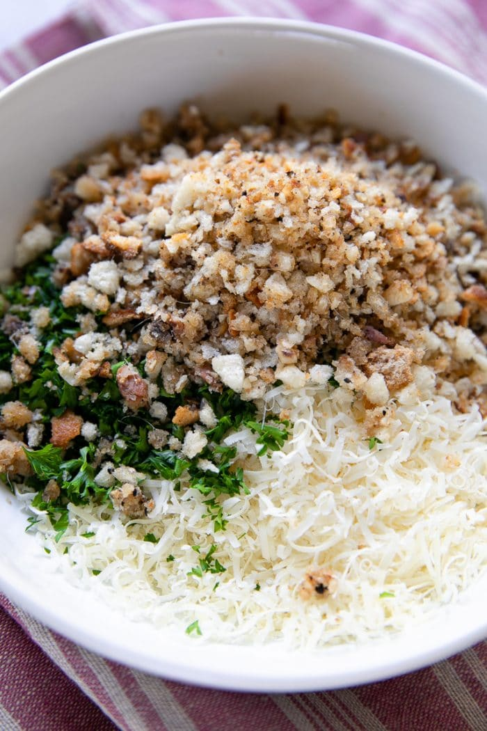 Mixture of parmesan cheese, Italian bread crumbs, parsley, and anchovies
