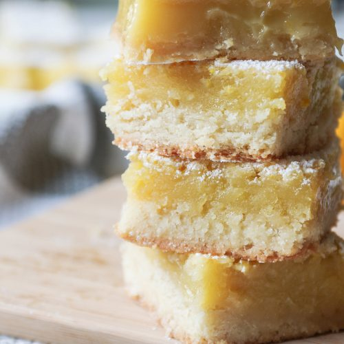 stacked up lemon bars on cutting board
