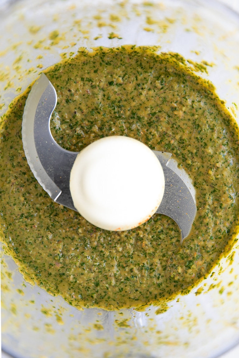 A close up of cilantro Lime marinade being blended