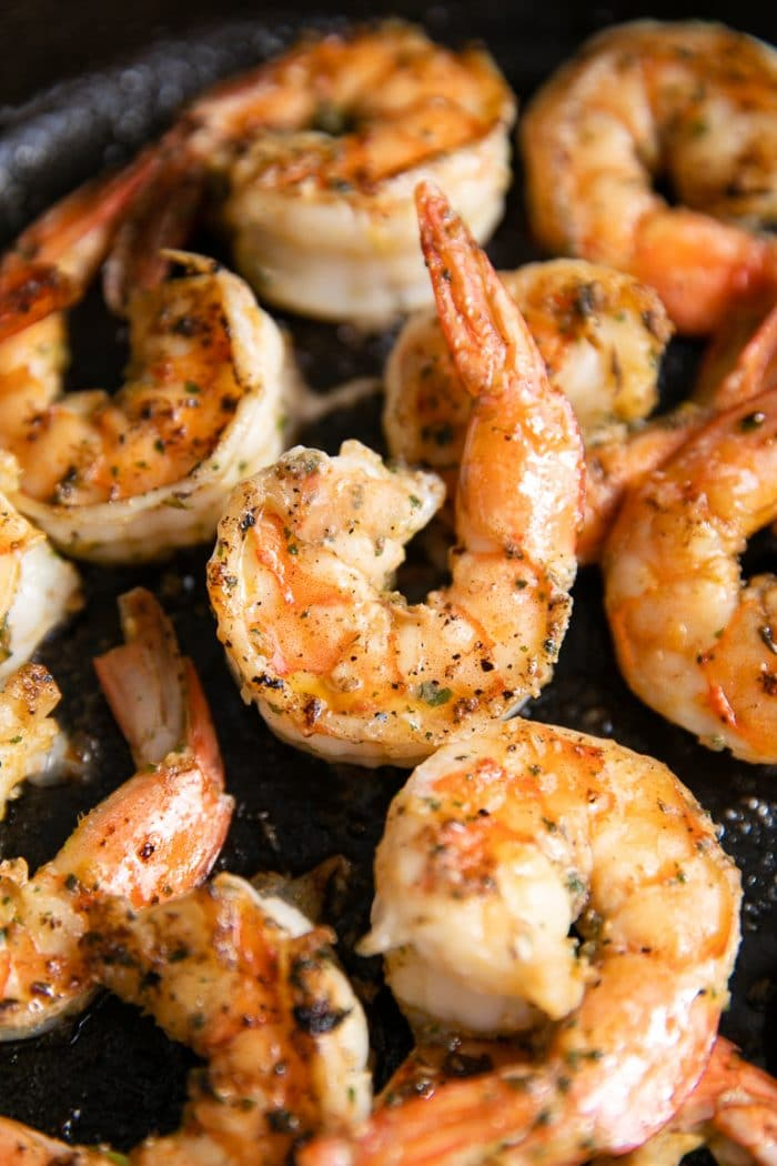 Close up image of fully cooked cilantro lime shrimp.