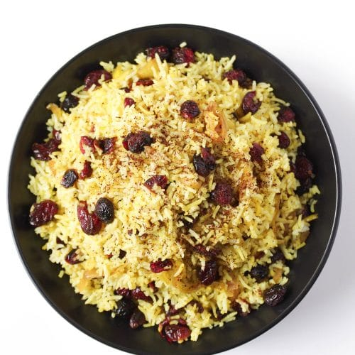 A close up of a plate of Persian cranberry rice pilaf