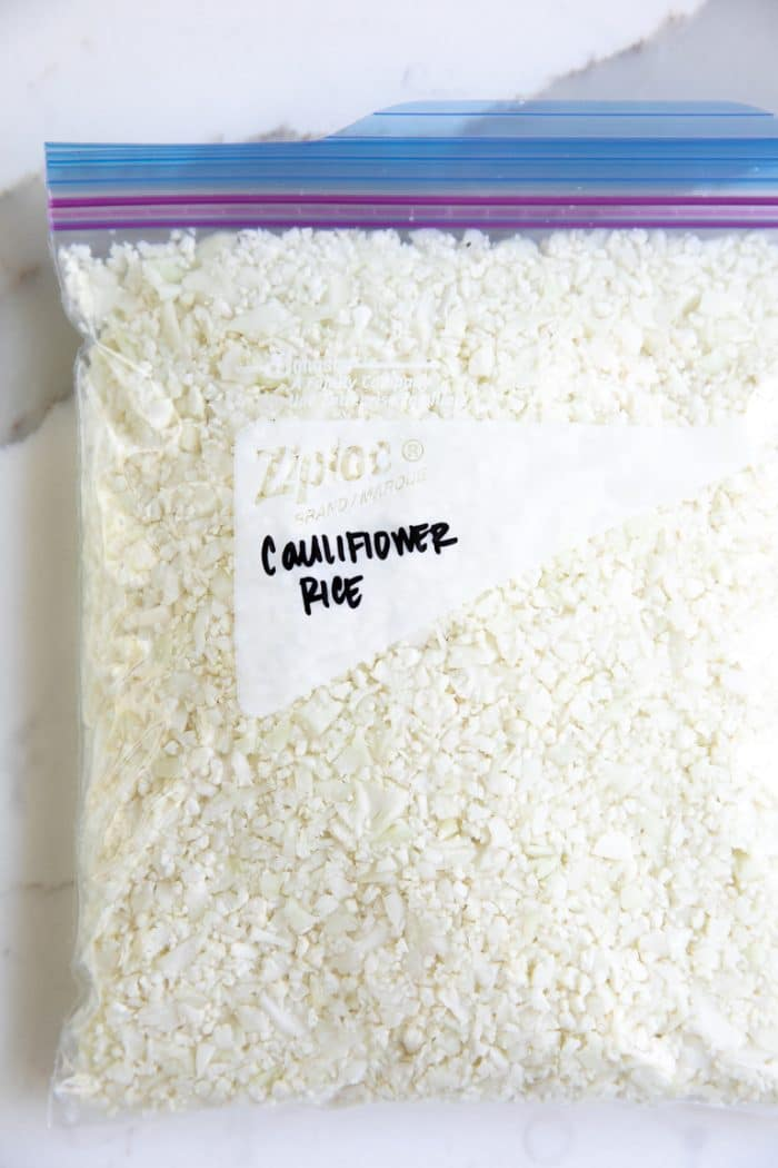 Ziplock bag filled with riced cauliflower ready to be frozen.