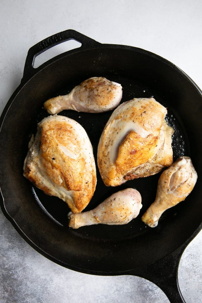 Pan-seared chicken in a cast iron skillet.