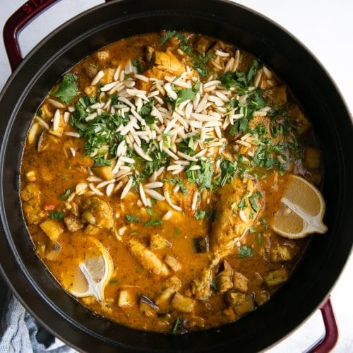 a pan of Moroccan chicken stew in a pot