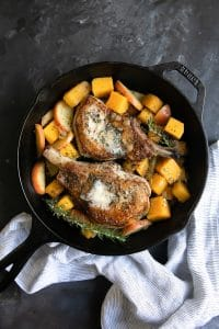 A pan filled with food, with Apple and Pork and butternut squash