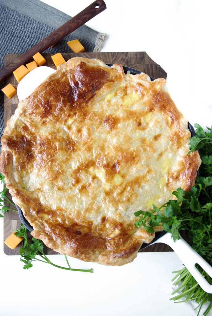A skillet of chicken butternut squash alfredo pie
