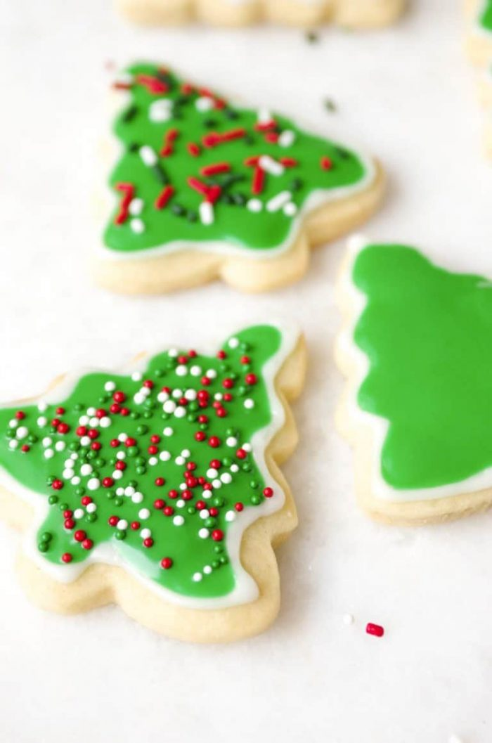 Close up image of a decorated Christmas tree sugar cookie with green frosting