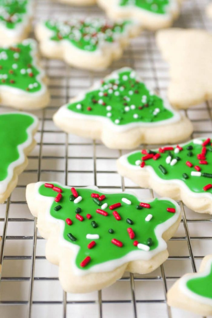Christmas tree sugar cookies with icing and Christmas colored sprinkles