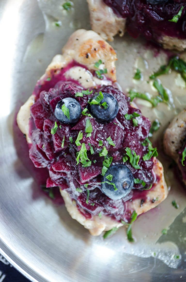 close up of Easy Pork Chops with Blueberry Apple Compote in stainless steel skillet