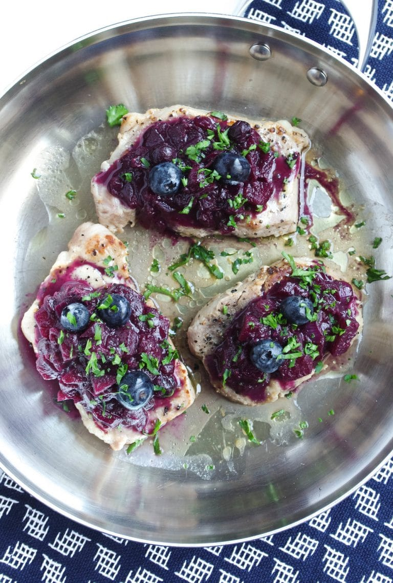 skillet wtih 3 Pork Chops with Blueberry Apple Compote
