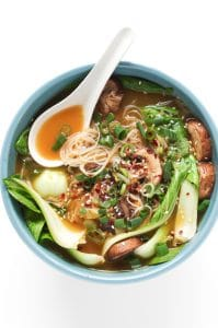 Bowl with Garlic Noodle Soup With Bok Choy, chicken broth, mushrooms, onions, sesame seeds