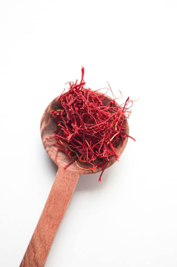 Small spoon filled with saffron threads.