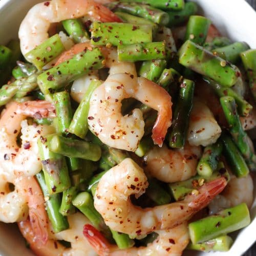 A plate of shrimp and vegetables
