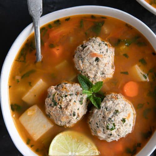 A bowl of albondigas soup