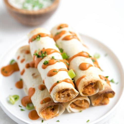 A plate of buffalo chicken Taquito