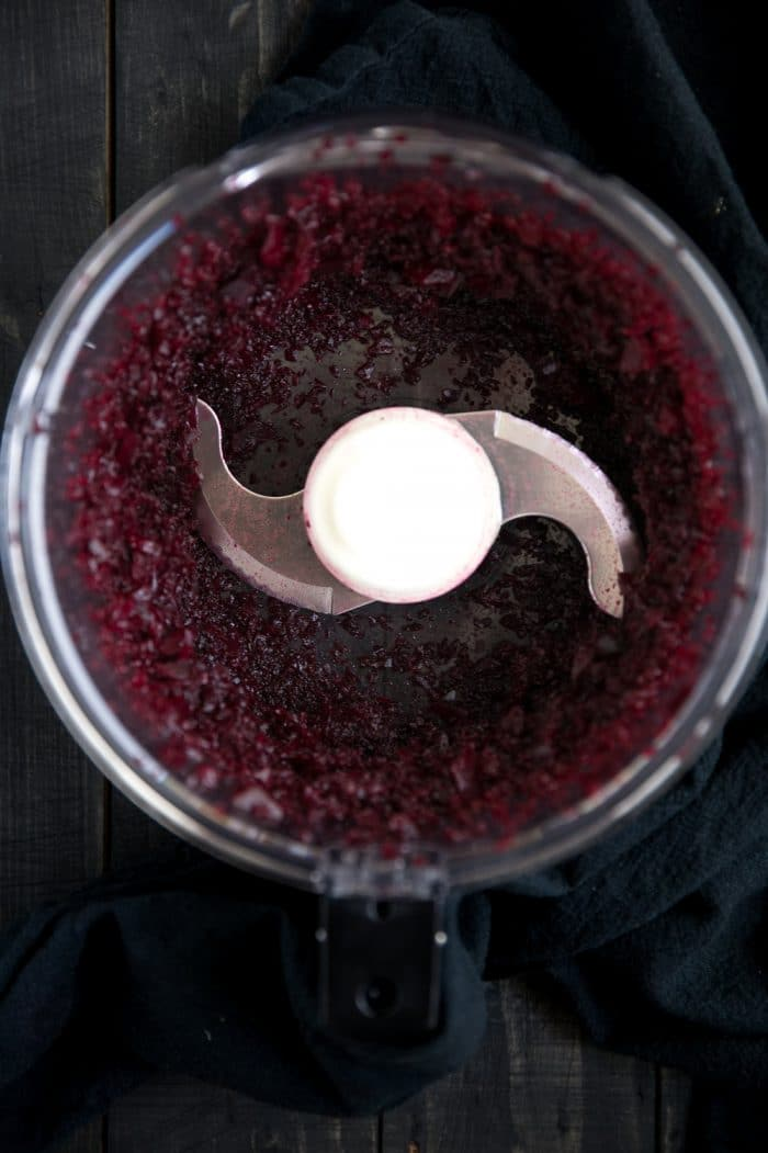 Finely processed beets in a large food processor.