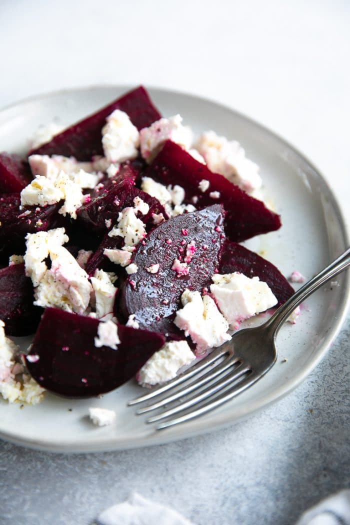 Beet and feta salad on a small grey salad plate.