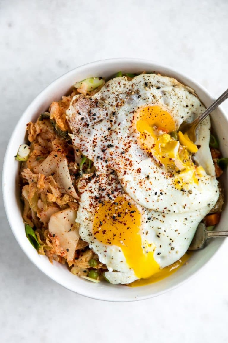 This fast and easy Kimchi Cauliflower Fried Rice is filled with fresh vegetables and perfectly fried eggs