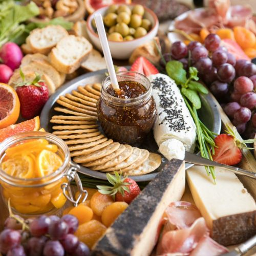 Welcome spring with this easy and colorful Spring Cheese Board complete with colorful fruits, yummy cheeses, salty meats, crackers, candied Meyer lemons, chocolate and delicious wines.