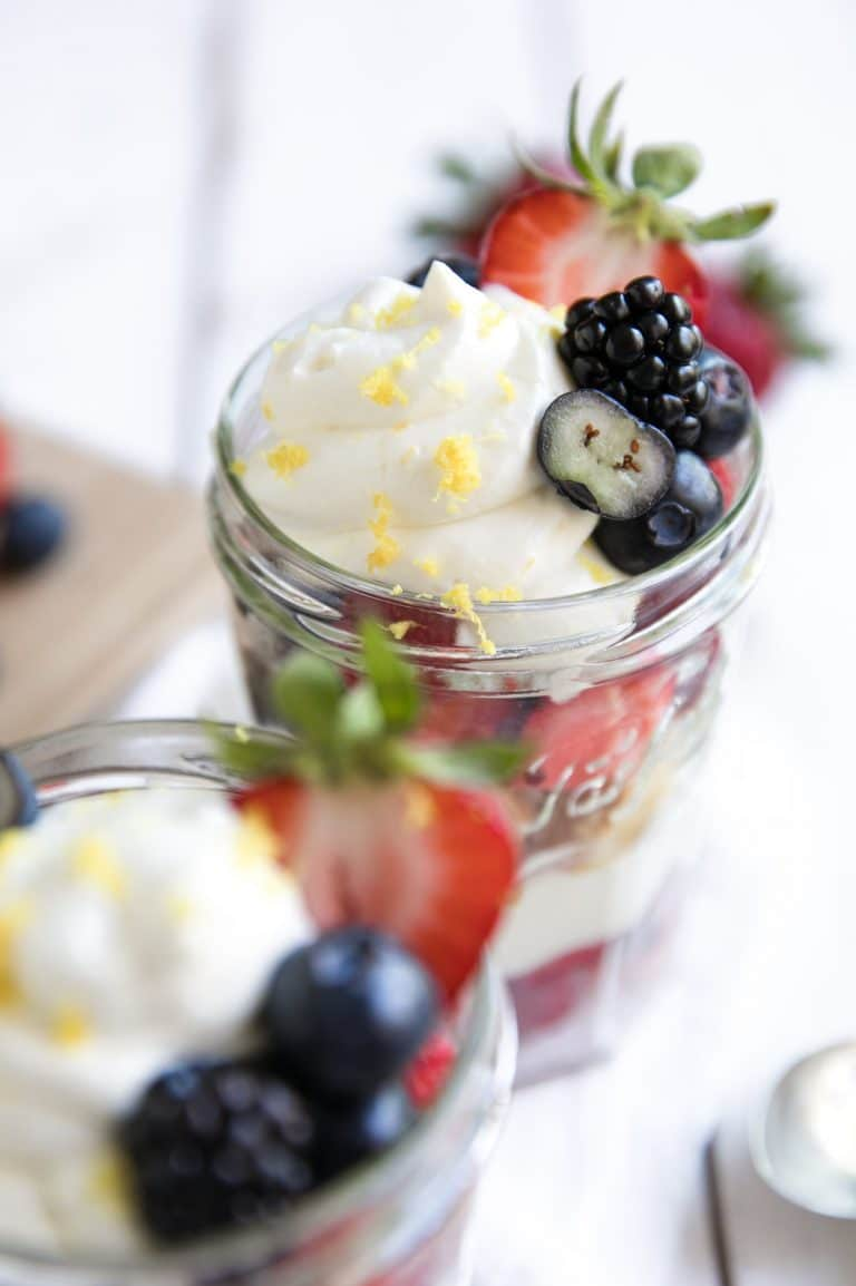 glasses filled with Berries, Lemon Cake and Honey Lemon Yogurt Mascarpone Cream