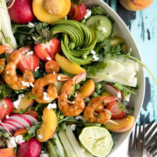 A plate of food, with Salad and shrimp