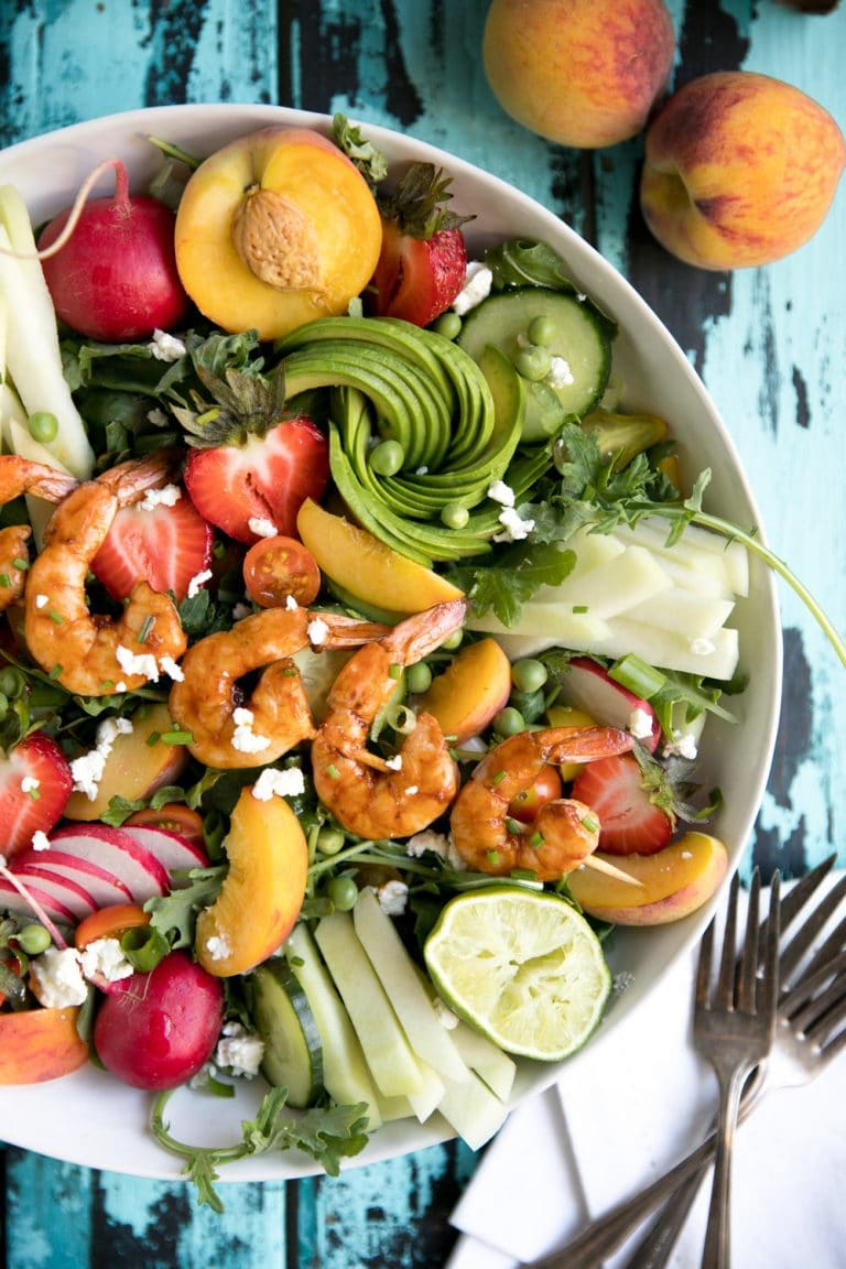 Delicious and refreshing, this Fruit and Vegetable Summer Salad explodes with all the awesome flavors of sweet peaches, kohlrabi, strawberries, and spicy chipotle shrimp!