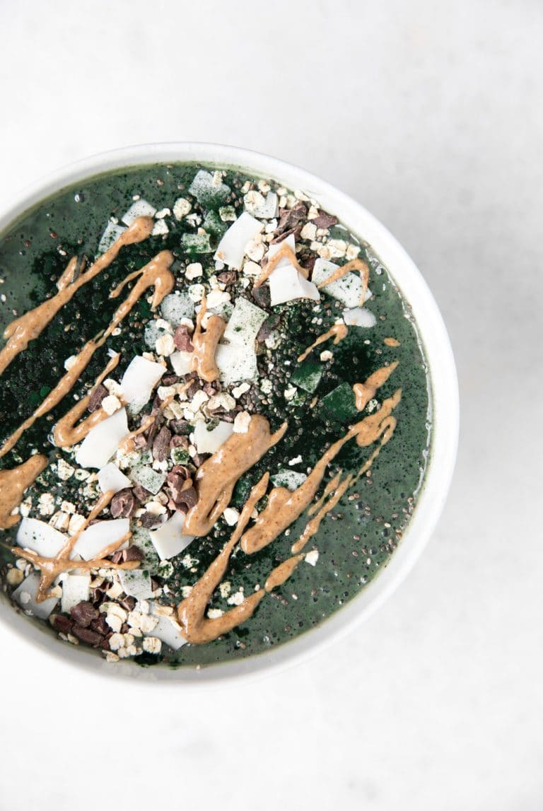 Almond Butter and Spirulina Smoothie Bowl drizzled with peanut butter