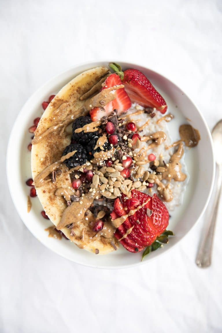Buckwheat Oatmeal Breakfast Bowl drizzled in peanut butter
