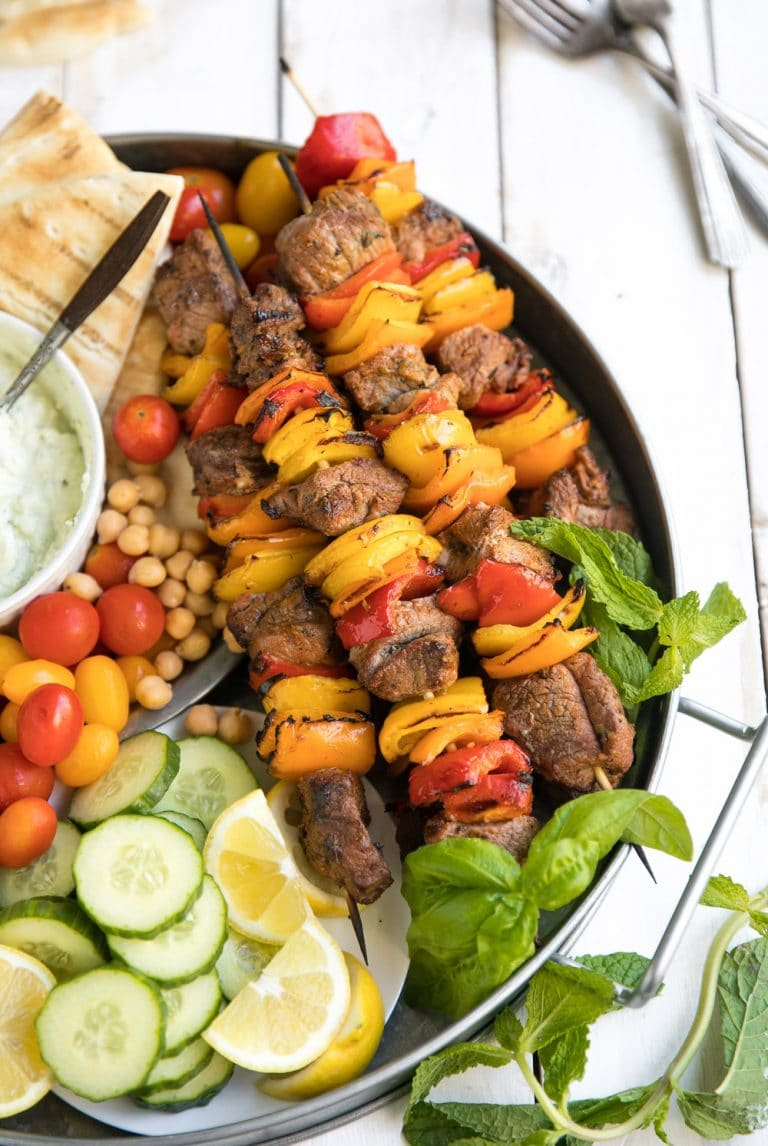 close up of kebabs on Grilled Lamb Kebab Platter with Basil Goat Cheese