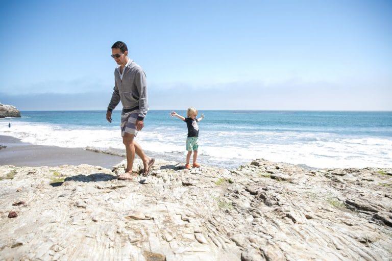 father sun playing near tidepools