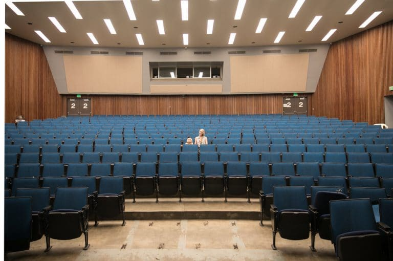 mother and son in large empty USCS lecture hall