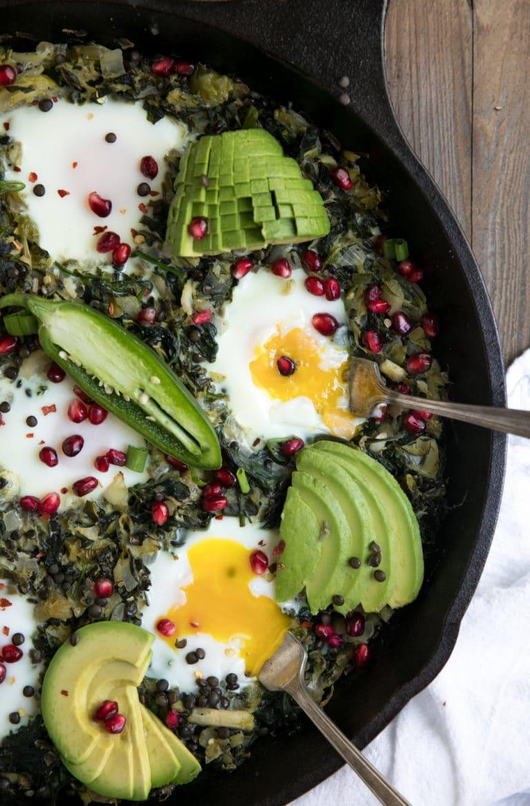 close up of popped egg in Green Shakshuka