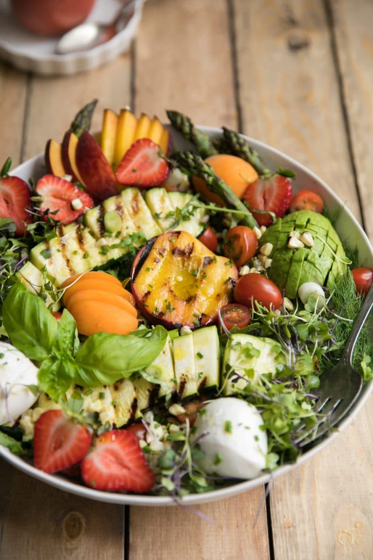 overhead photo of Grilled Peach, Corn, Zucchini and Asparagus Summer Salad with Strawberry Vinaigrette
