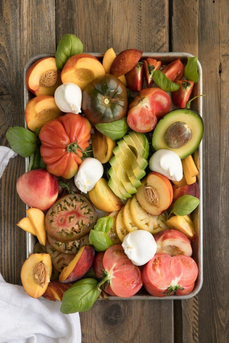 overhead photo of Stone Fruit and Burrata with Avocado, tomatoes, basil