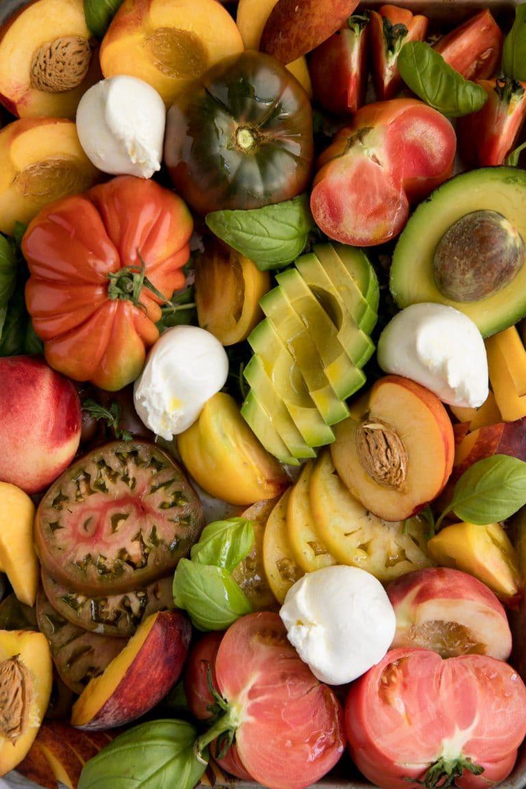 Heirloom tomatoes with sliced avocado, Stone Fruit, Burrata
