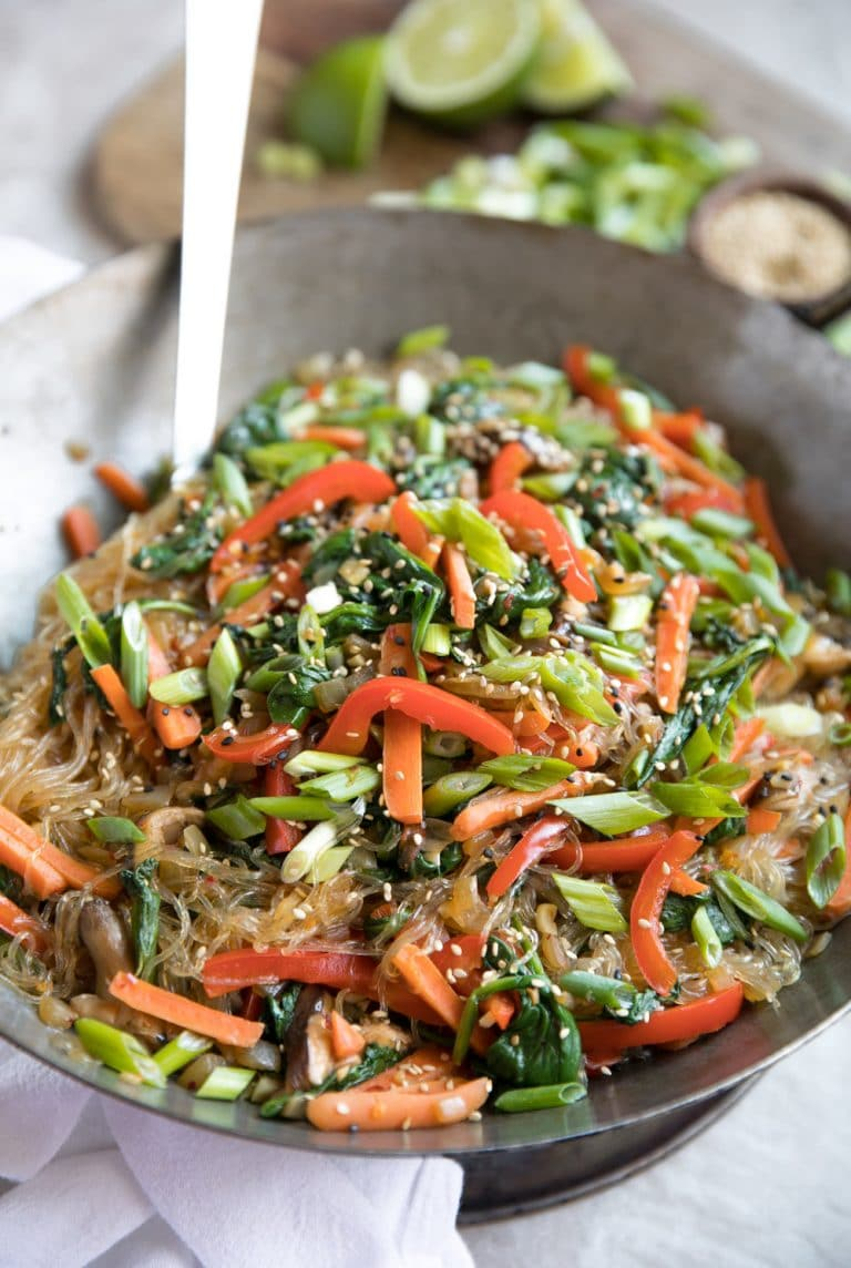 Korean Glass Noodle Stir-Fry in wok with spatula