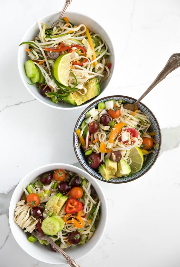 three bowls filled with 10 Minute Toasted Sesame Chopped Noodle Salad