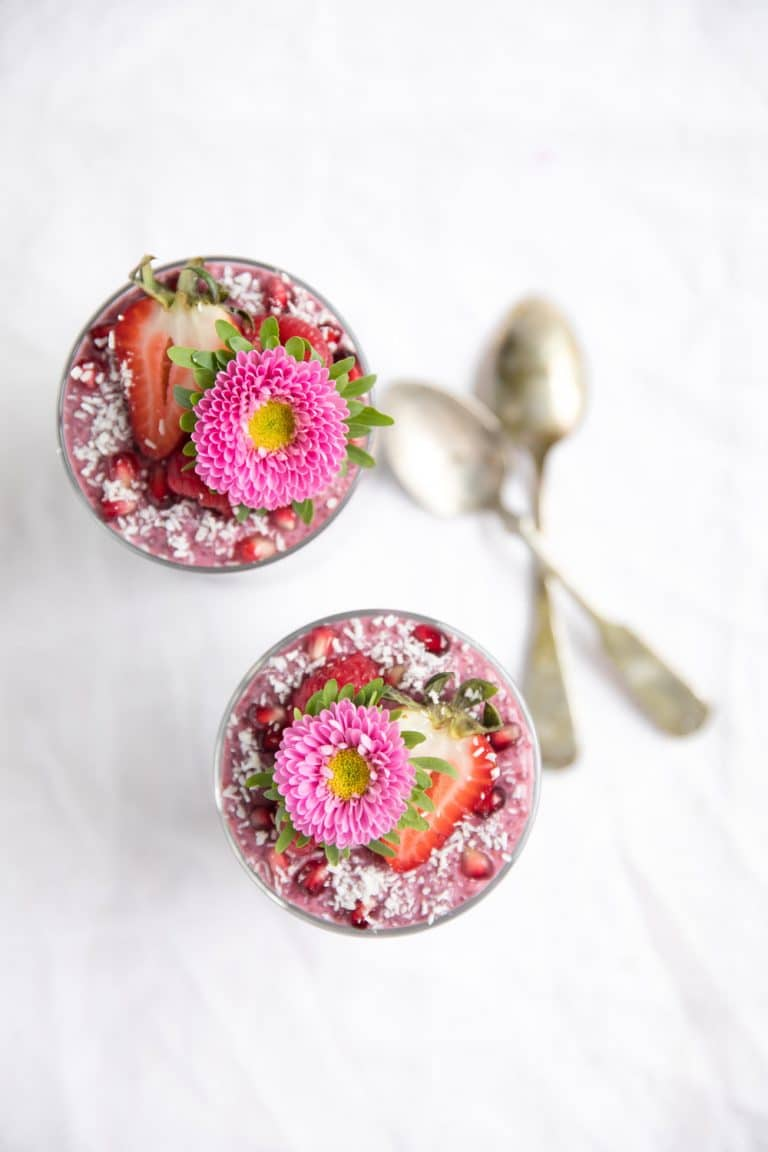 overhead photo of Triple Layer Chia Pudding Cup with flower on top