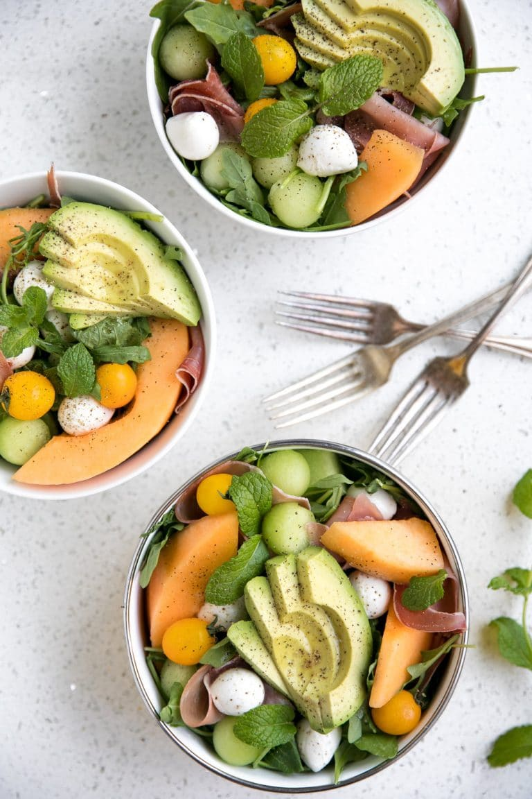melon and mozzarella salad with prosciutto in three bowls