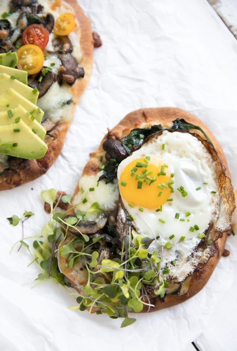 close up overhead photo of Breakfast Naan Pizza with Sauteéd Mushrooms and Shallots